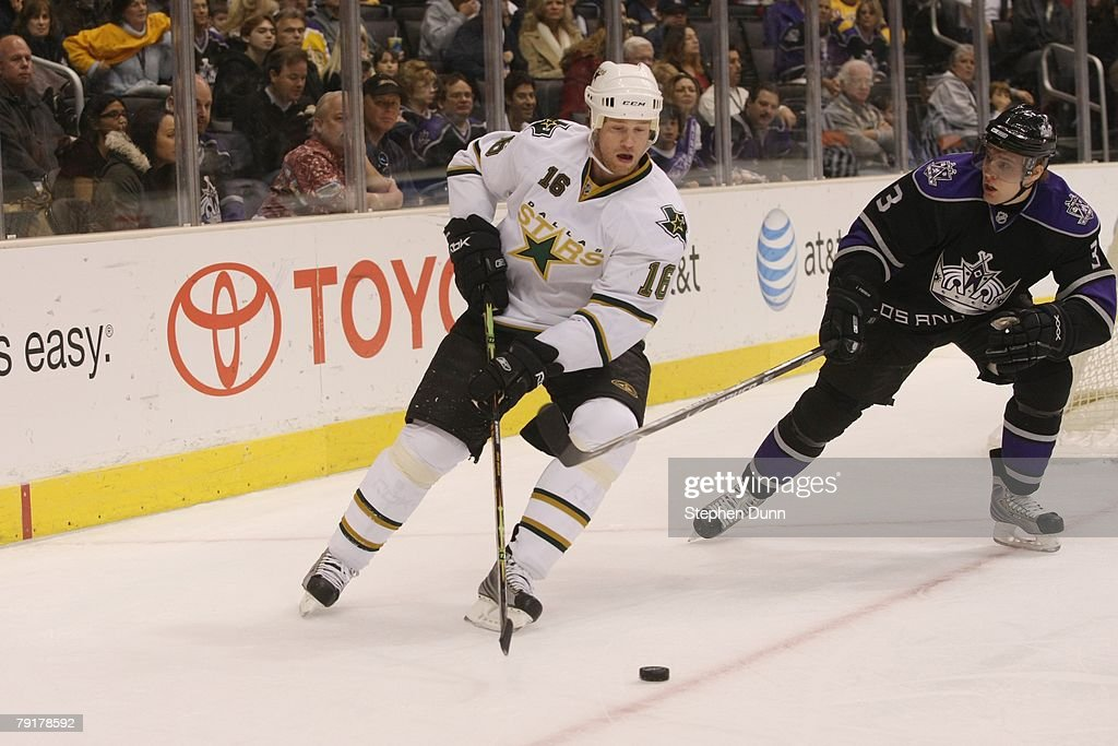 Brad Winchester #16 of the Dallas Stars skates with the puck as he is pressured by Jack Johnson #3 of the Los Angeles Kings during their NHL game on January 12, 2008 at Staples Center in Los Angeles, California.