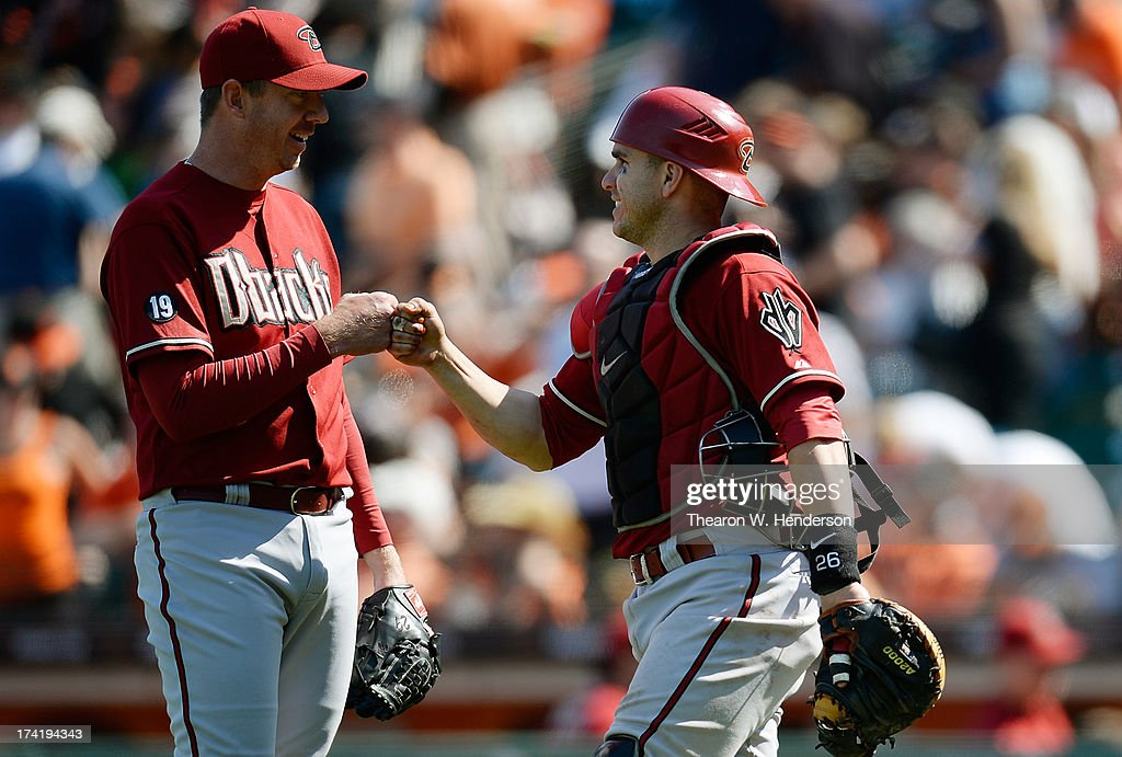 <a gi-track='captionPersonalityLinkClicked' href=/galleries/search?phrase=Brad+Ziegler&family=editorial&specificpeople=4921772 ng-click='$event.stopPropagation()'>Brad Ziegler</a> #29 and <a gi-track='captionPersonalityLinkClicked' href=/galleries/search?phrase=Miguel+Montero&family=editorial&specificpeople=836495 ng-click='$event.stopPropagation()'>Miguel Montero</a> #26 celebrates defeating the San Francisco Giants 3-1 at AT&T Park on July 21, 2013 in San Francisco, California.