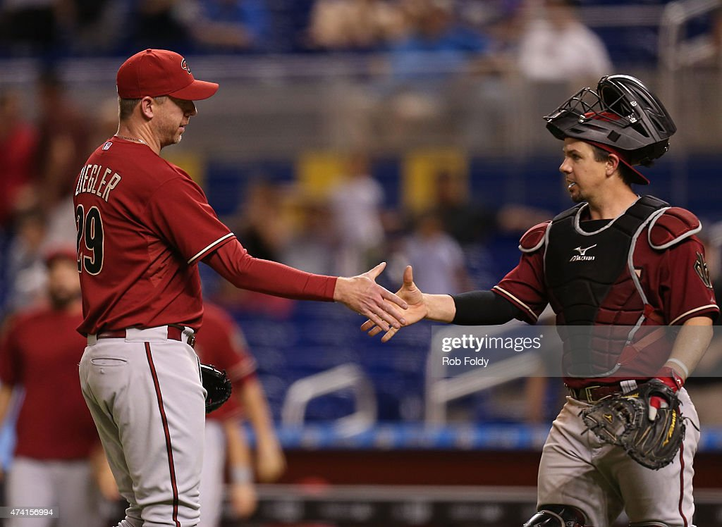 Brad Ziegler #29 and Tuffy Gosewisch #9 of the Arizona Diamondbacks celebrate after defeating the Miami Marlins in the game at Marlins Park on May 20, 2015 in Miami, Florida.