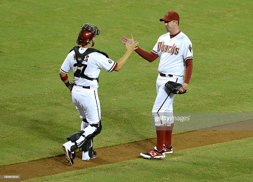 <a gi-track='captionPersonalityLinkClicked' href=/galleries/search?phrase=Brad+Ziegler&family=editorial&specificpeople=4921772 ng-click='$event.stopPropagation()'>Brad Ziegler</a> #29 and <a gi-track='captionPersonalityLinkClicked' href=/galleries/search?phrase=Wil+Nieves&family=editorial&specificpeople=835752 ng-click='$event.stopPropagation()'>Wil Nieves</a> #27 of the Arizona Diamondbacks celebrate a win against the Los Angeles Dodgers at Chase Field on September 16, 2013 in Phoenix, Arizona. Arizona won 2-1.