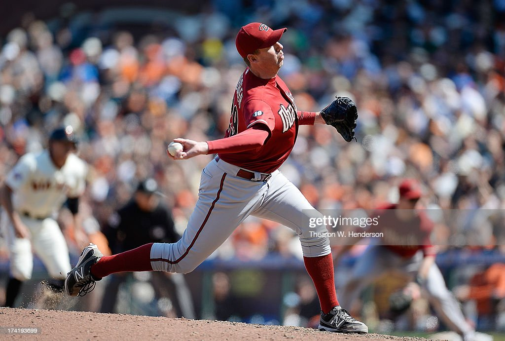 <a gi-track='captionPersonalityLinkClicked' href=/galleries/search?phrase=Brad+Ziegler&family=editorial&specificpeople=4921772 ng-click='$event.stopPropagation()'>Brad Ziegler</a> #29 of the Arizona Diamondbacks pitches in the ninth inning against the San Francisco Giants at AT&T Park on July 21, 2013 in San Francisco, California. The Diamondbacks won the game 3-1.