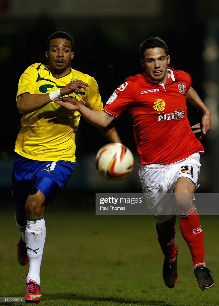 Bradden Inman (R) of Crewe in action with Cyrus Christie of Coventry during the Johnstone's Paint Trophy Northern Section Final Second Leg match between Crewe Alexandra and Coventry City at the Alexandra Stadium on February 20, 2013 in Crewe, England.