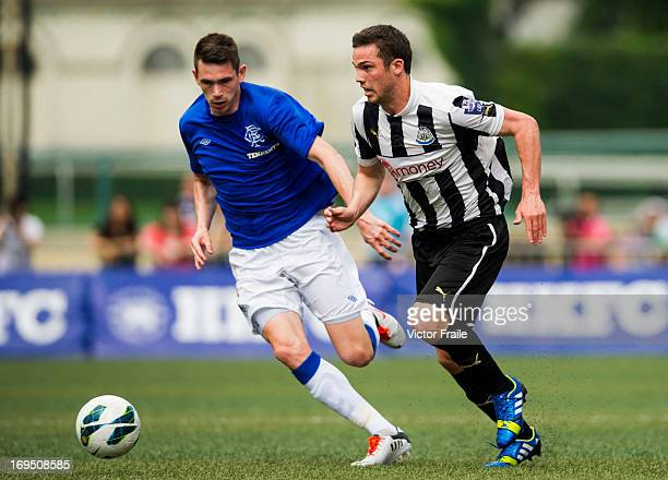Bradden Inman of Newcastle United and Kyle McAusland Rangers fight for the ball on day three of the Hong Kong International Soccer Sevens at Hong...