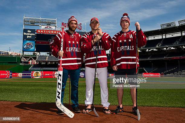 Braden Holtby Alex Ovechkin and Nicklas Backstrom of the Washington Capitals pose wearing the Capitals 2014 Winter Classic jersey during a press...