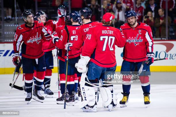 Braden Holtby and Alex Ovechkin of the Washington Capitals celebrate after defeating the San Jose Sharks 41 at Capital One Arena on December 4 2017...