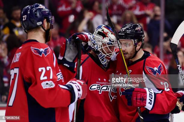 Braden Holtby and Kevin Shattenkirk of the Washington Capitals celebrate after the Capitals defeated the Pittsburgh Penguins 42 in Game Five of the...