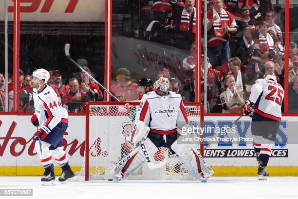 Braden Holtby Brooks Orpik and Devante SmithPelly of the Washington Capitals reacts after a third period goal by Mark Stone of the Ottawa Senators at...
