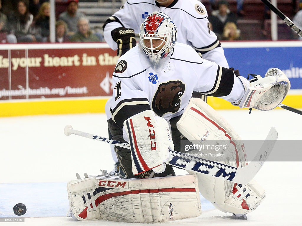 <a gi-track='captionPersonalityLinkClicked' href=/galleries/search?phrase=Braden+Holtby&family=editorial&specificpeople=5370964 ng-click='$event.stopPropagation()'>Braden Holtby</a> #1 of the Hershey Bears makes a save during an American Hockey League game against the Worcester Sharks on January 6, 2013 at the Giant Center in Hershey, Pennsylvania.