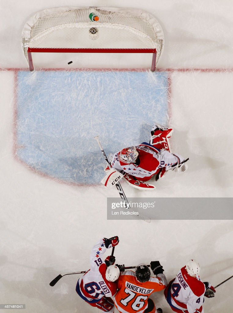 <a gi-track='captionPersonalityLinkClicked' href=/galleries/search?phrase=Braden+Holtby&family=editorial&specificpeople=5370964 ng-click='$event.stopPropagation()'>Braden Holtby</a> #70 of the Washington Capitals allows a goal in the second period from Mark Streit #32 of the Philadelphia Flyers(not pictured) on December 17, 2013 at the Wells Fargo Center in Philadelphia, Pennsylvania. The Flyers went on to defeat the Capitals 5-2.