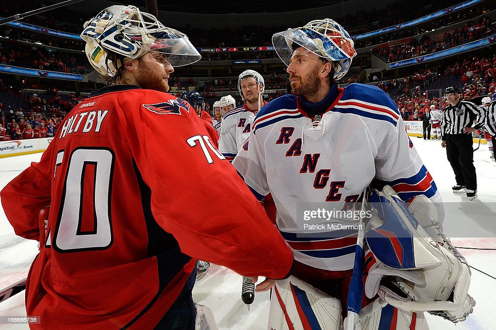 <a gi-track='captionPersonalityLinkClicked' href=/galleries/search?phrase=Braden+Holtby&family=editorial&specificpeople=5370964 ng-click='$event.stopPropagation()'>Braden Holtby</a> #70 of the Washington Capitals and <a gi-track='captionPersonalityLinkClicked' href=/galleries/search?phrase=Henrik+Lundqvist&family=editorial&specificpeople=217958 ng-click='$event.stopPropagation()'>Henrik Lundqvist</a> #30 of the New York Rangers shake hands after Game Seven of the Eastern Conference Quarterfinals during the 2013 NHL Stanley Cup Playoffs, the Rangers defeated the Capitals 5-0, at Verizon Center on May 13, 2013 in Washington, DC.