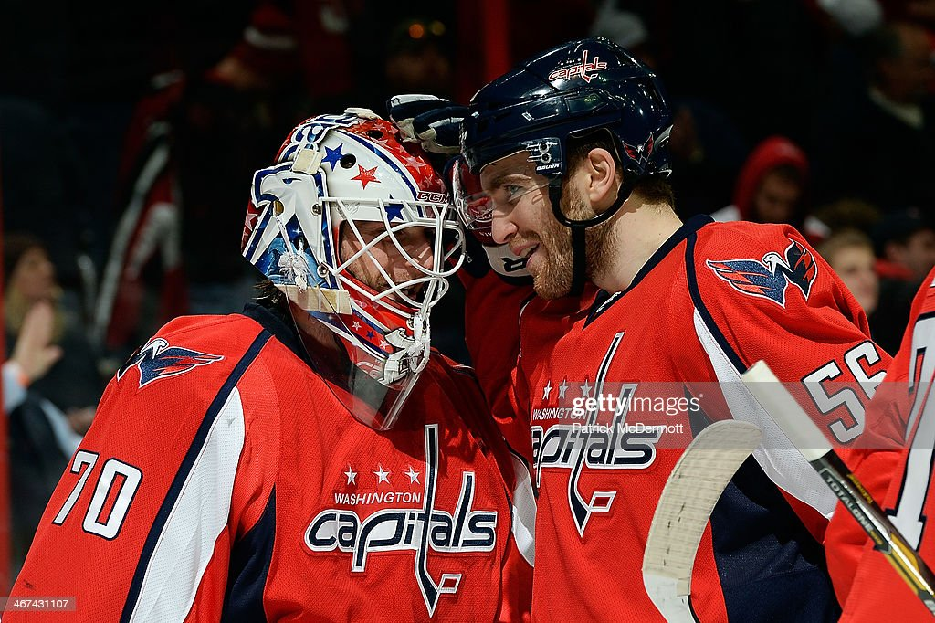 <a gi-track='captionPersonalityLinkClicked' href=/galleries/search?phrase=Braden+Holtby&family=editorial&specificpeople=5370964 ng-click='$event.stopPropagation()'>Braden Holtby</a> #70 of the Washington Capitals celebrates with Patrick Wey #56 after the Capitals defeated the Winnipeg Jets 4-2 during an NHL game at Verizon Center on February 6, 2014 in Washington, DC.