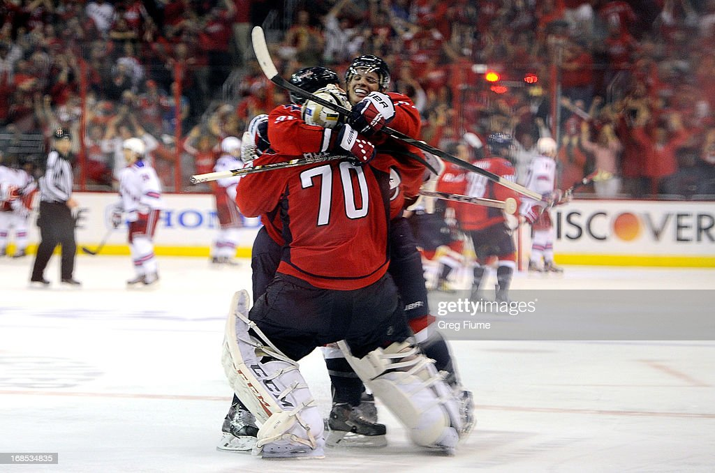 <a gi-track='captionPersonalityLinkClicked' href=/galleries/search?phrase=Braden+Holtby&family=editorial&specificpeople=5370964 ng-click='$event.stopPropagation()'>Braden Holtby</a> #70 of the Washington Capitals celebrates with teammate John Carlson #74 after a 2-1 overtime victory against the New York Rangers in Game Five of the Eastern Conference Quarterfinals during the 2013 NHL Stanley Cup Playoffs at the Verizon Center on May 10, 2013 in Washington, DC.