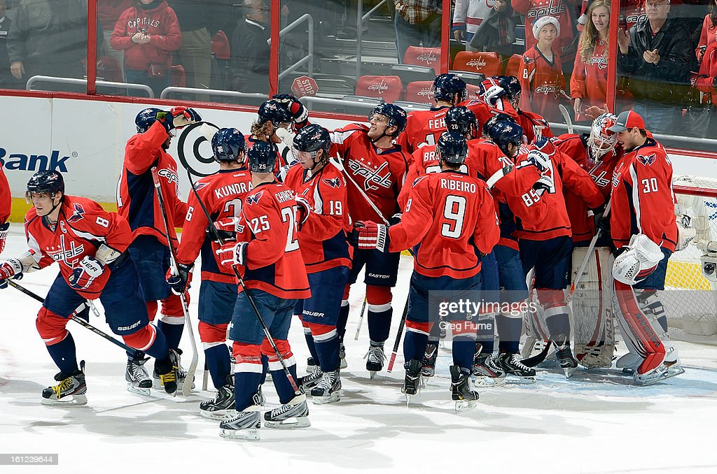 <a gi-track='captionPersonalityLinkClicked' href=/galleries/search?phrase=Braden+Holtby&family=editorial&specificpeople=5370964 ng-click='$event.stopPropagation()'>Braden Holtby</a> #70 of the Washington Capitals celebrates with teammates after a 5-0 victory against the Florida Panthers at the Verizon Center on February 9, 2013 in Washington, DC.