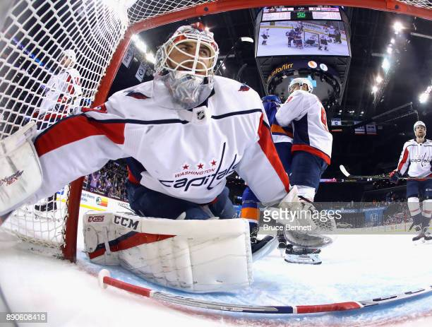 Braden Holtby of the Washington Capitals checks the net after a disallowed goal during the first period at the Barclays Center on December 11 2017 in...