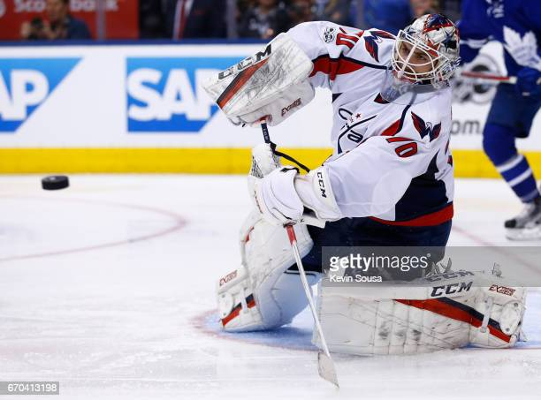 Braden Holtby of the Washington Capitals clears the puck during the second period of play against the Toronto Maple Leafs in Game Four of the Eastern...