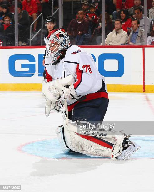 Braden Holtby of the Washington Capitals defends his net against the New Jersey Devils during the game at Prudential Center on October 13 2017 in...