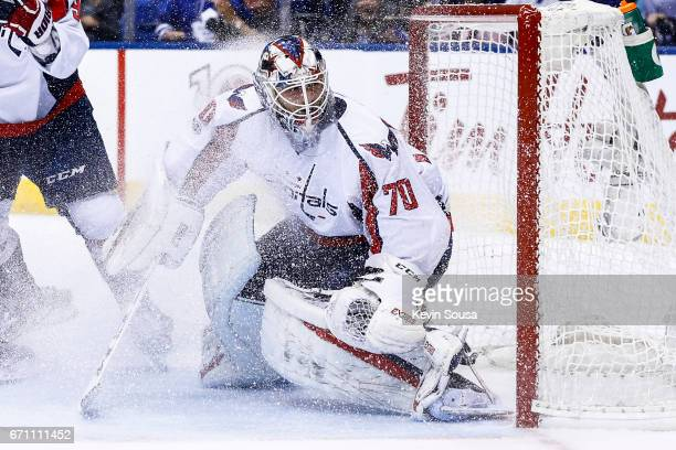 Braden Holtby of the Washington Capitals gets snowed during the second period in Game Four of the Eastern Conference First Round during the 2017 NHL...