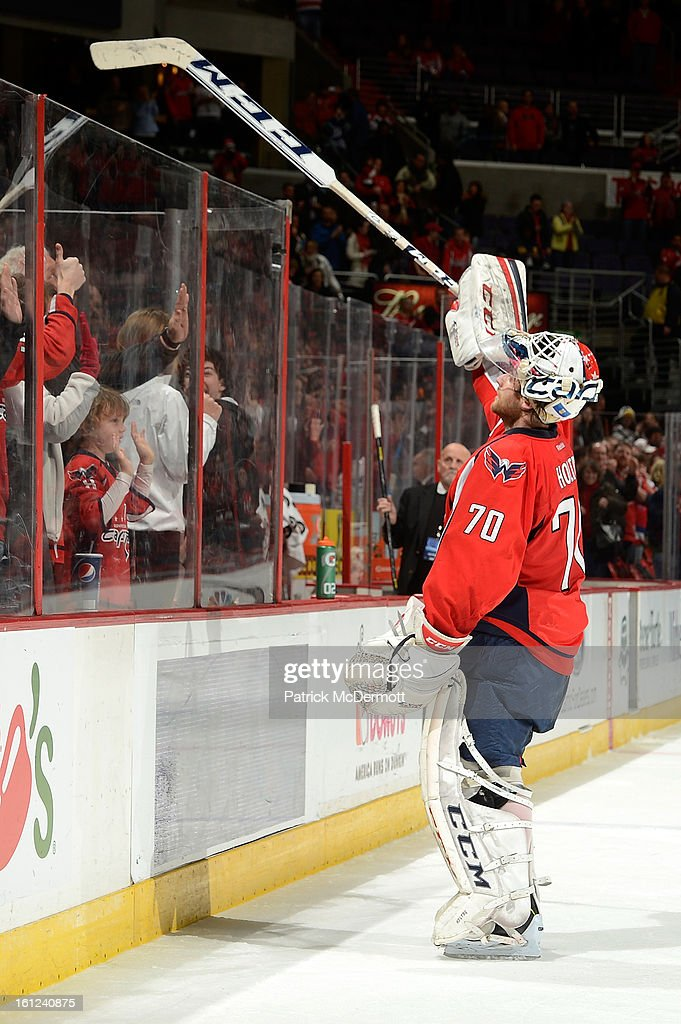 Braden Holtby #70 of the Washington Capitals gives his stick to a fan after an NHL hockey game in which the Washington Capitals defeated the Florida Panthers 5-0. Holtby recorded his first shutout of the season. at Verizon Center on February 9, 2013 in Washington, DC.