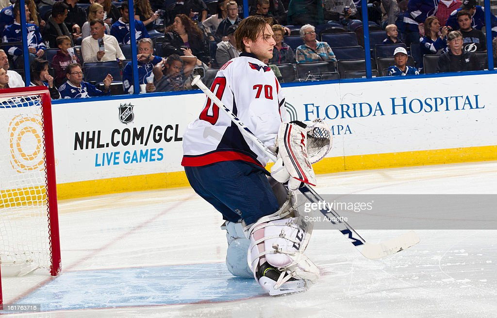 Braden Holtby #70 of the Washington Capitals guards the goal during the first period of the game against the Tampa Bay Lightning at the Tampa Bay Times Forum on February 14, 2013 in Tampa, Florida.