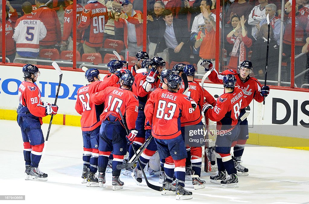 <a gi-track='captionPersonalityLinkClicked' href=/galleries/search?phrase=Braden+Holtby&family=editorial&specificpeople=5370964 ng-click='$event.stopPropagation()'>Braden Holtby</a> #70 of the Washington Capitals is congratulated by teammates after a 3-1 victory against the New York Rangers in Game One of the Eastern Conference Quarterfinals during the 2013 NHL Stanley Cup Playoffs at Verizon Center on May 2, 2013 in Washington, DC.