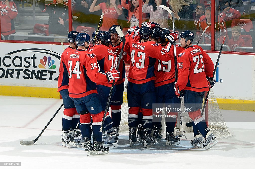 <a gi-track='captionPersonalityLinkClicked' href=/galleries/search?phrase=Braden+Holtby&family=editorial&specificpeople=5370964 ng-click='$event.stopPropagation()'>Braden Holtby</a> #70 of the Washington Capitals is congratulated by teammates after a 4-2 victory against the Edmonton Oilers at the Verizon Center on October 14, 2013 in Washington, DC.