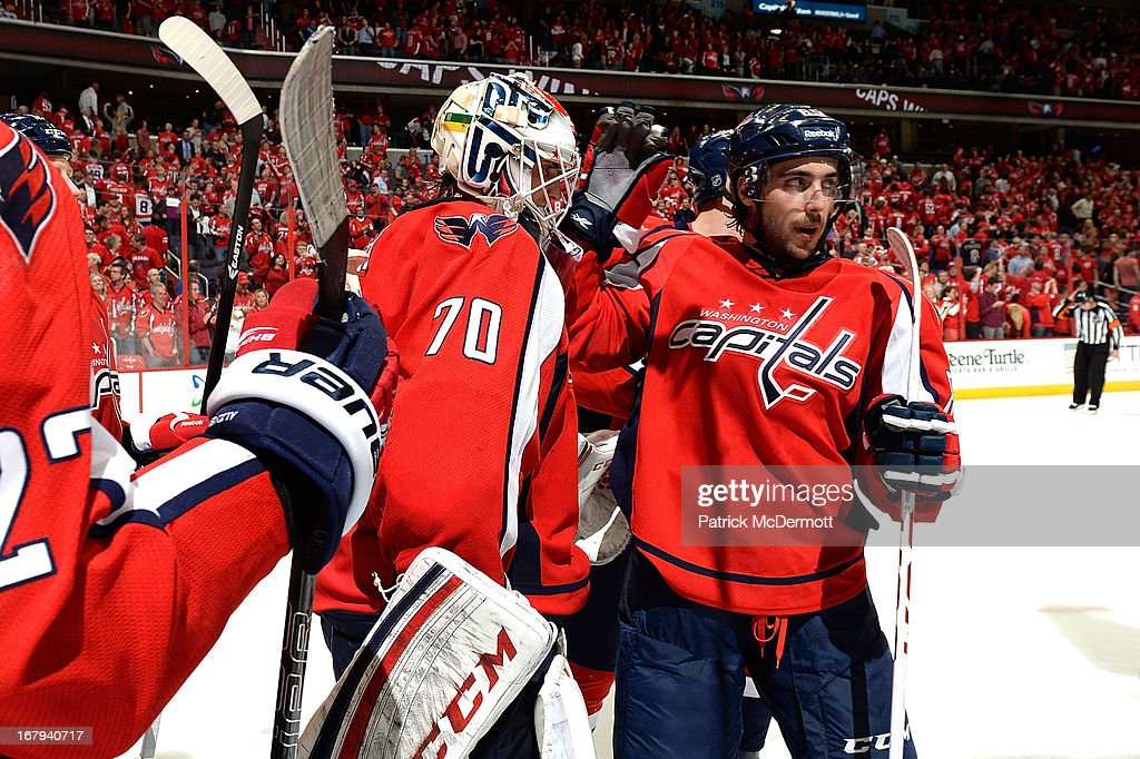 <a gi-track='captionPersonalityLinkClicked' href=/galleries/search?phrase=Braden+Holtby&family=editorial&specificpeople=5370964 ng-click='$event.stopPropagation()'>Braden Holtby</a> #70 (Left) of the Washington Capitals is congratulated by teammate <a gi-track='captionPersonalityLinkClicked' href=/galleries/search?phrase=Mathieu+Perreault&family=editorial&specificpeople=776813 ng-click='$event.stopPropagation()'>Mathieu Perreault</a> #85 (Right) following the Capitals 3-1 victory in Game One of the Eastern Conference Quarterfinals during the 2013 NHL Stanley Cup Playoffs at Verizon Center on May 2, 2013 in Washington
