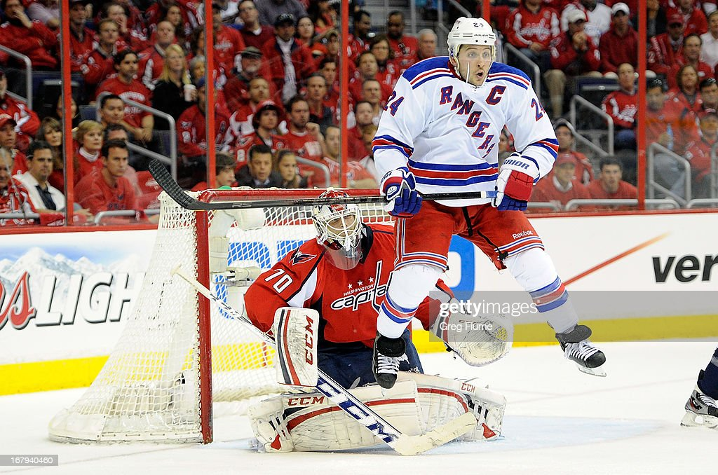 <a gi-track='captionPersonalityLinkClicked' href=/galleries/search?phrase=Braden+Holtby&family=editorial&specificpeople=5370964 ng-click='$event.stopPropagation()'>Braden Holtby</a> #70 of the Washington Capitals is screened by <a gi-track='captionPersonalityLinkClicked' href=/galleries/search?phrase=Ryan+Callahan&family=editorial&specificpeople=809690 ng-click='$event.stopPropagation()'>Ryan Callahan</a> #24 of the New York Rangers in the second period of Game One of the Eastern Conference Quarterfinals during the 2013 NHL Stanley Cup Playoffs at Verizon Center on May 2, 2013 in Washington, DC. Washington won the game 3-1.