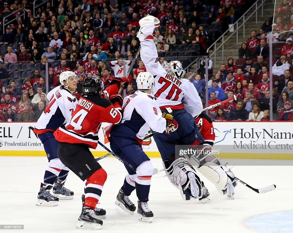 <a gi-track='captionPersonalityLinkClicked' href=/galleries/search?phrase=Braden+Holtby&family=editorial&specificpeople=5370964 ng-click='$event.stopPropagation()'>Braden Holtby</a> #70 of the Washington Capitals jumps to catch the puck in the overtime period against the Washington Capitals on February 6, 2016 at Prudential Center in Newark, New Jersey.The Washington Capitals defeated the New Jersey Devils 3-2 in an overtime shootout.