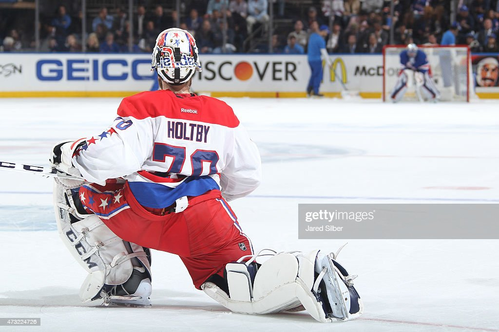 <a gi-track='captionPersonalityLinkClicked' href=/galleries/search?phrase=Braden+Holtby&family=editorial&specificpeople=5370964 ng-click='$event.stopPropagation()'>Braden Holtby</a> #70 of the Washington Capitals looks down the ice at <a gi-track='captionPersonalityLinkClicked' href=/galleries/search?phrase=Henrik+Lundqvist&family=editorial&specificpeople=217958 ng-click='$event.stopPropagation()'>Henrik Lundqvist</a> #30 of the New York Rangers during a TV timeout during Game Seven of the Eastern Conference Semifinals during the 2015 NHL Stanley Cup Playoffs at Madison Square Garden on May 13, 2015 in New York City.