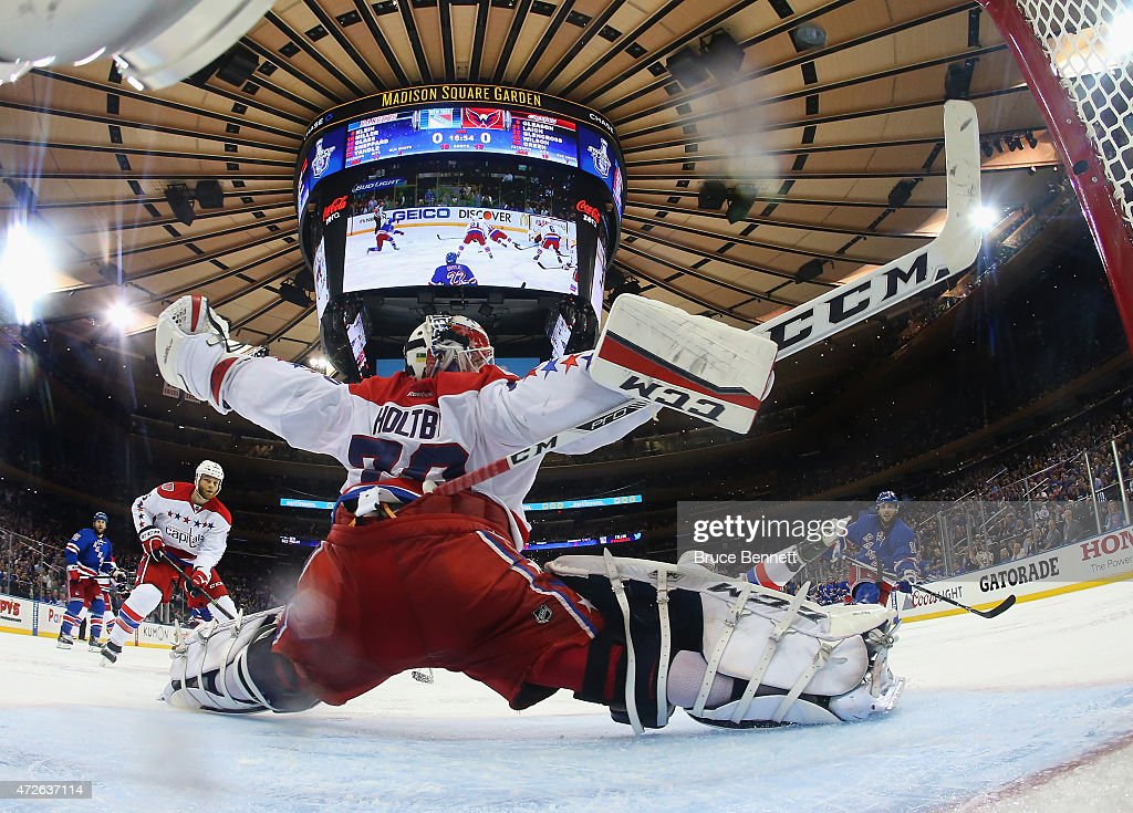 <a gi-track='captionPersonalityLinkClicked' href=/galleries/search?phrase=Braden+Holtby&family=editorial&specificpeople=5370964 ng-click='$event.stopPropagation()'>Braden Holtby</a> #70 of the Washington Capitals make sthe second period save on <a gi-track='captionPersonalityLinkClicked' href=/galleries/search?phrase=Derick+Brassard&family=editorial&specificpeople=540468 ng-click='$event.stopPropagation()'>Derick Brassard</a> #16 of the New York Rangers (r) in Game Five of the Eastern Conference Semifinals during the 2015 NHL Stanley Cup Playoffs at Madison Square Garden on May 8, 2015 in New York City.