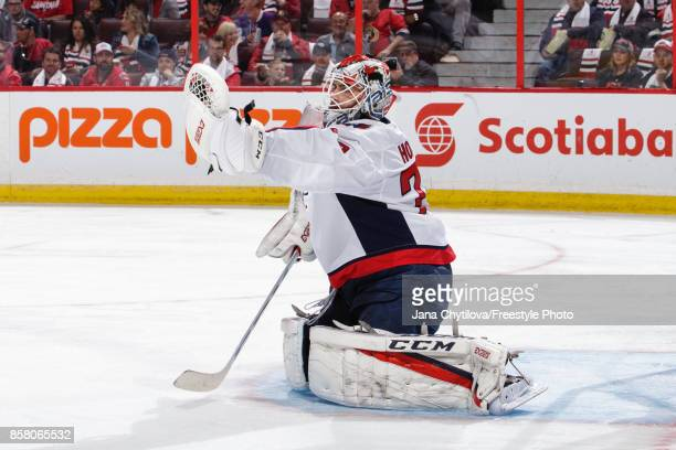 Braden Holtby of the Washington Capitals makes a glove save against the Ottawa Senators in the second period at Canadian Tire Centre on October 5...