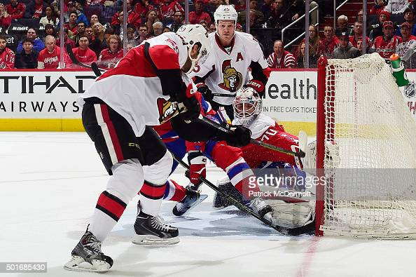 Braden Holtby of the Washington Capitals makes a save against David Dziurzynski of the Ottawa Senators in the second period during an NHL game at...