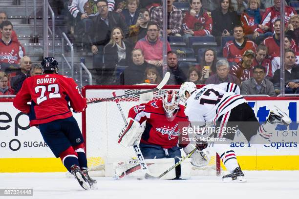 Braden Holtby of the Washington Capitals makes a save against Lance Bouma of the Chicago Blackhawks in the first period at Capital One Arena on...