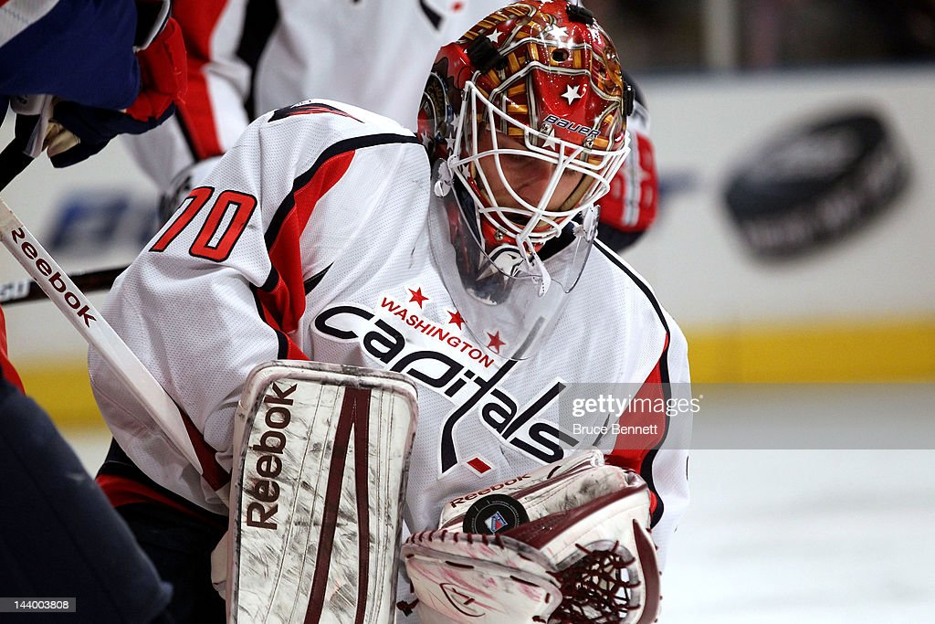 <a gi-track='captionPersonalityLinkClicked' href=/galleries/search?phrase=Braden+Holtby&family=editorial&specificpeople=5370964 ng-click='$event.stopPropagation()'>Braden Holtby</a> #70 of the Washington Capitals makes a save against the New York Rangers in Game Five of the Eastern Conference Semifinals during the 2012 NHL Stanley Cup Playoffs at Madison Square Garden on May 7, 2012 in New York City.