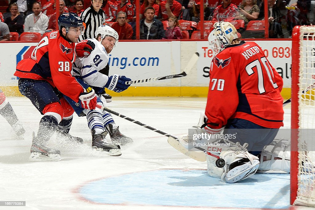 <a gi-track='captionPersonalityLinkClicked' href=/galleries/search?phrase=Braden+Holtby&family=editorial&specificpeople=5370964 ng-click='$event.stopPropagation()'>Braden Holtby</a> #70 of the Washington Capitals makes a save as <a gi-track='captionPersonalityLinkClicked' href=/galleries/search?phrase=Jack+Hillen&family=editorial&specificpeople=5088928 ng-click='$event.stopPropagation()'>Jack Hillen</a> #38 battles with <a gi-track='captionPersonalityLinkClicked' href=/galleries/search?phrase=Phil+Kessel&family=editorial&specificpeople=537794 ng-click='$event.stopPropagation()'>Phil Kessel</a> #81 of the Toronto Maple Leafs during the second period of an NHL game at Verizon Center on April 16, 2013 in Washington, DC.