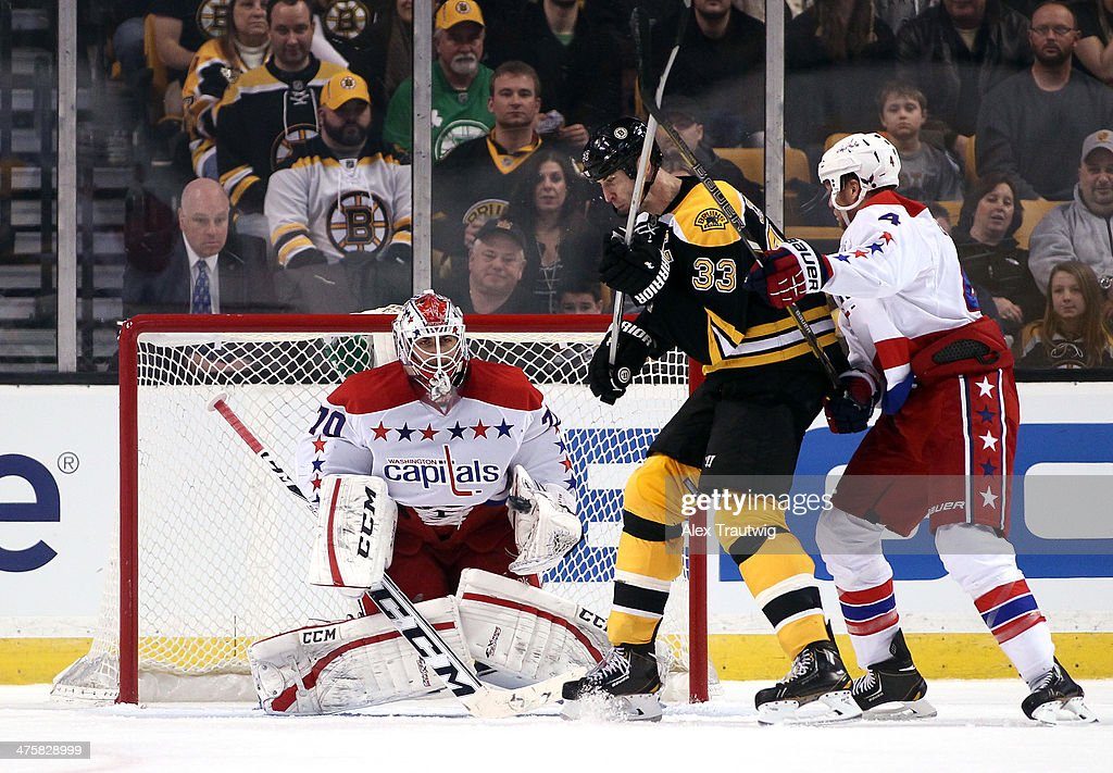 <a gi-track='captionPersonalityLinkClicked' href=/galleries/search?phrase=Braden+Holtby&family=editorial&specificpeople=5370964 ng-click='$event.stopPropagation()'>Braden Holtby</a> #70 of the Washington Capitals makes a save as <a gi-track='captionPersonalityLinkClicked' href=/galleries/search?phrase=Zdeno+Chara&family=editorial&specificpeople=203177 ng-click='$event.stopPropagation()'>Zdeno Chara</a> #33 of the Boston Bruins and <a gi-track='captionPersonalityLinkClicked' href=/galleries/search?phrase=John+Erskine&family=editorial&specificpeople=215268 ng-click='$event.stopPropagation()'>John Erskine</a> #4 of the Washington Capitals battle in front of the net during a game at the TD Garden on March 1, 2014 in Boston, Massachusetts.