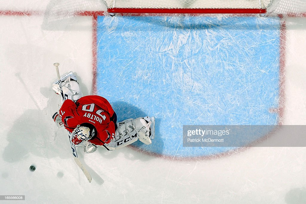 <a gi-track='captionPersonalityLinkClicked' href=/galleries/search?phrase=Braden+Holtby&family=editorial&specificpeople=5370964 ng-click='$event.stopPropagation()'>Braden Holtby</a> #70 of the Washington Capitals makes a save during an NHL game against the New York Islanders at Verizon Center on April 4, 2013 in Washington, DC.