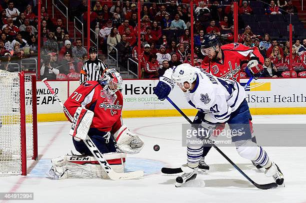 Braden Holtby of the Washington Capitals makes a save in the first period against the Toronto Maple Leafs during an NHL game at Verizon Center on...