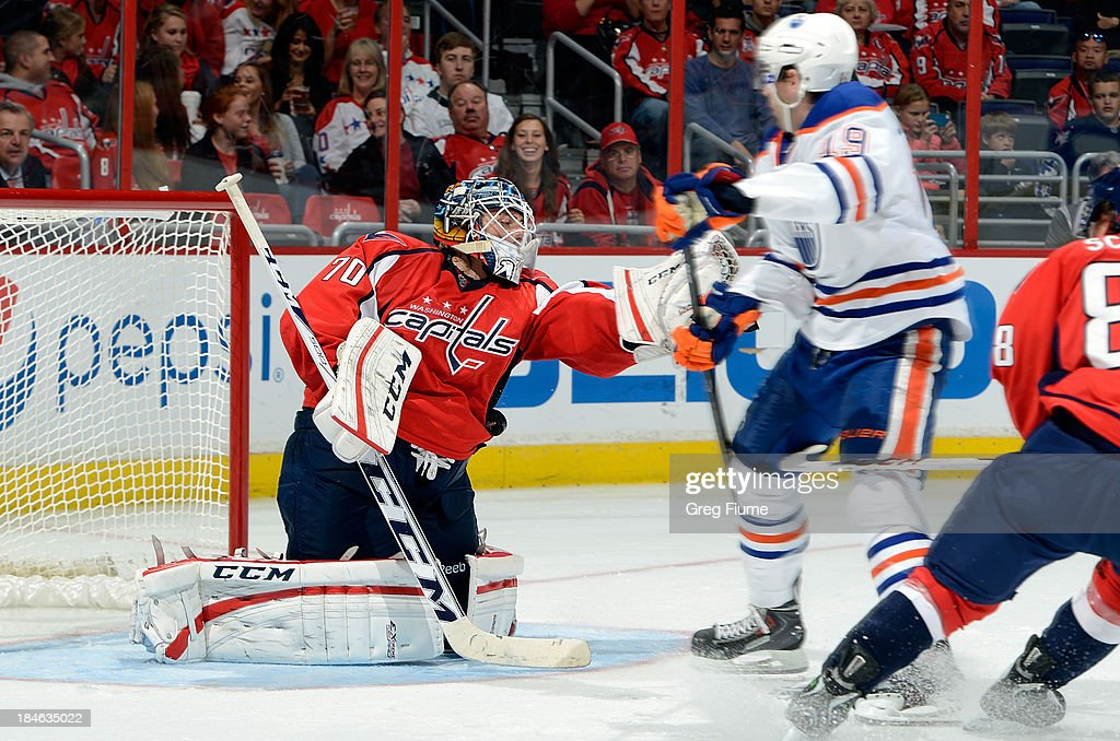 <a gi-track='captionPersonalityLinkClicked' href=/galleries/search?phrase=Braden+Holtby&family=editorial&specificpeople=5370964 ng-click='$event.stopPropagation()'>Braden Holtby</a> #70 of the Washington Capitals makes a save in the second period against <a gi-track='captionPersonalityLinkClicked' href=/galleries/search?phrase=Justin+Schultz&family=editorial&specificpeople=5370958 ng-click='$event.stopPropagation()'>Justin Schultz</a> #19 of the Edmonton Oilers at the Verizon Center on October 14, 2013 in Washington, DC.