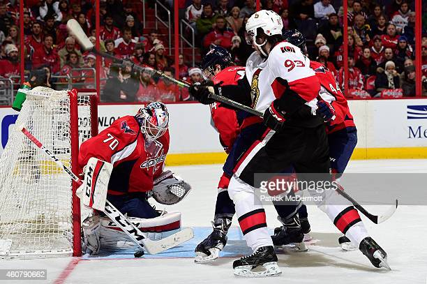 Braden Holtby of the Washington Capitals makes a save in the third period during an NHL game against the Ottawa Senators at Verizon Center on...