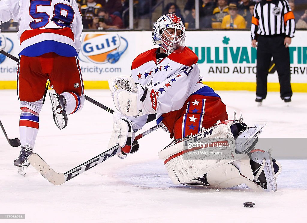 <a gi-track='captionPersonalityLinkClicked' href=/galleries/search?phrase=Braden+Holtby&family=editorial&specificpeople=5370964 ng-click='$event.stopPropagation()'>Braden Holtby</a> #70 of the Washington Capitals makes a save in the third period against the Boston Bruins during the game at TD Garden on March 6, 2014 in Boston, Massachusetts.