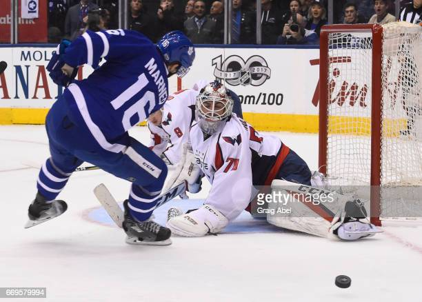 Braden Holtby of the Washington Capitals makes a save on Mitch Marner of the Toronto Maple Leafs during the first period in Game Three of the Eastern...