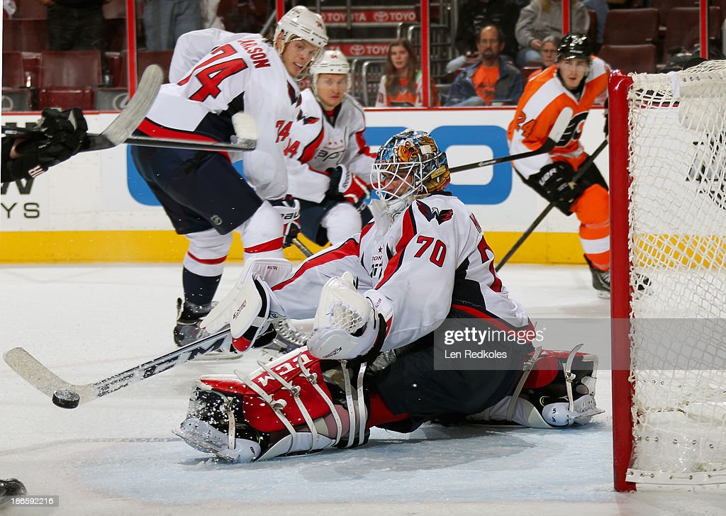 <a gi-track='captionPersonalityLinkClicked' href=/galleries/search?phrase=Braden+Holtby&family=editorial&specificpeople=5370964 ng-click='$event.stopPropagation()'>Braden Holtby</a> #70 of the Washington Capitals makes a stick save against the Philadelphia Flyers on November 1, 2013 at the Wells Fargo Center in Philadelphia, Pennsylvania. The Capitals went on to defeat the Flyers 7-0.