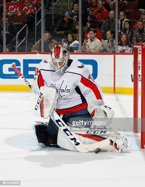 Braden Holtby of the Washington Capitals makes a stick save against the New Jersey Devils during the game at Prudential Center on October 13 2017 in...