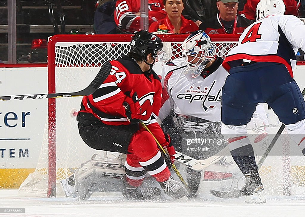 <a gi-track='captionPersonalityLinkClicked' href=/galleries/search?phrase=Braden+Holtby&family=editorial&specificpeople=5370964 ng-click='$event.stopPropagation()'>Braden Holtby</a> #70 of the Washington Capitals makes save against Joseph Blandisi #64 of the New Jersey Devils during the game at the Prudential Center on February 6, 2016 in Newark, New Jersey.