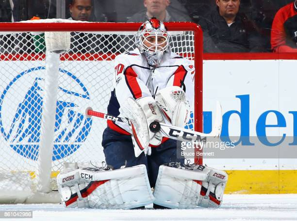 Braden Holtby of the Washington Capitals makes the first period stop against the New Jersey Devils at the Prudential Center on October 13 2017 in...