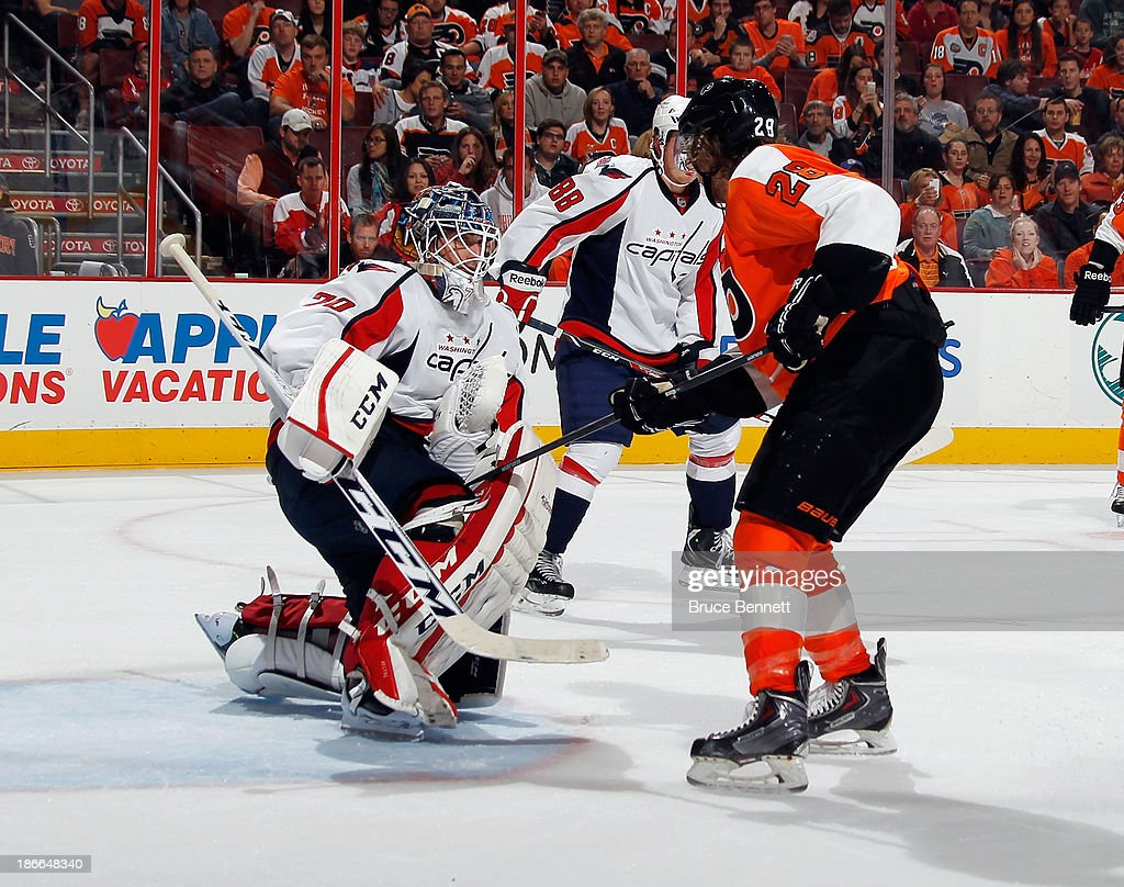 <a gi-track='captionPersonalityLinkClicked' href=/galleries/search?phrase=Braden+Holtby&family=editorial&specificpeople=5370964 ng-click='$event.stopPropagation()'>Braden Holtby</a> #70 of the Washington Capitals makes the save as <a gi-track='captionPersonalityLinkClicked' href=/galleries/search?phrase=Claude+Giroux&family=editorial&specificpeople=537961 ng-click='$event.stopPropagation()'>Claude Giroux</a> #28 of the Philadelphia Flyers looks for a rebound at the Wells Fargo Center on November 1, 2013 in Philadelphia, Pennsylvania.
