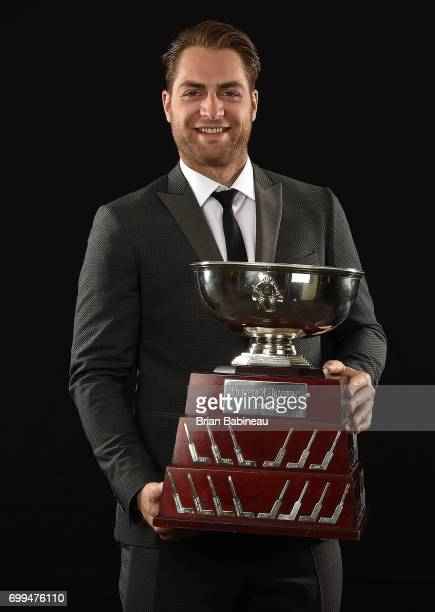 Braden Holtby of the Washington Capitals poses for a portrait with the William M Jennings Trophy at the 2017 NHL Awards at TMobile Arena on June 21...