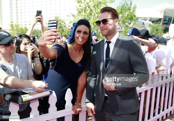 Braden Holtby of the Washington Capitals poses for a selfie photo as he arrives on the magenta carpet for the 2017 NHL Awards at TMobile Arena on...