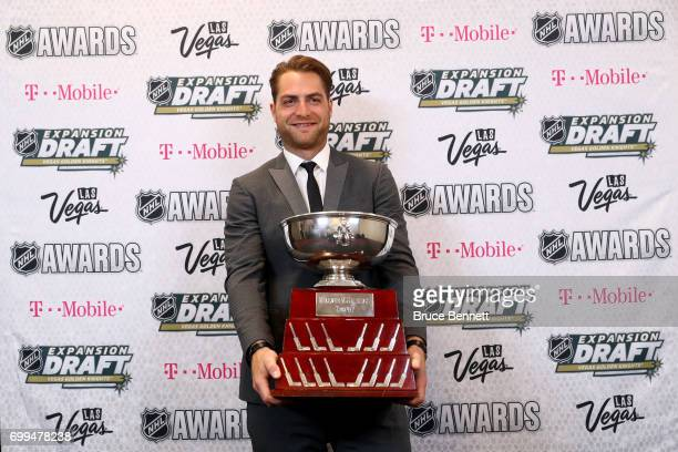 Braden Holtby of the Washington Capitals poses with the William M Jennings Trophy during the 2017 NHL Awards and Expansion Draft at TMobile Arena on...